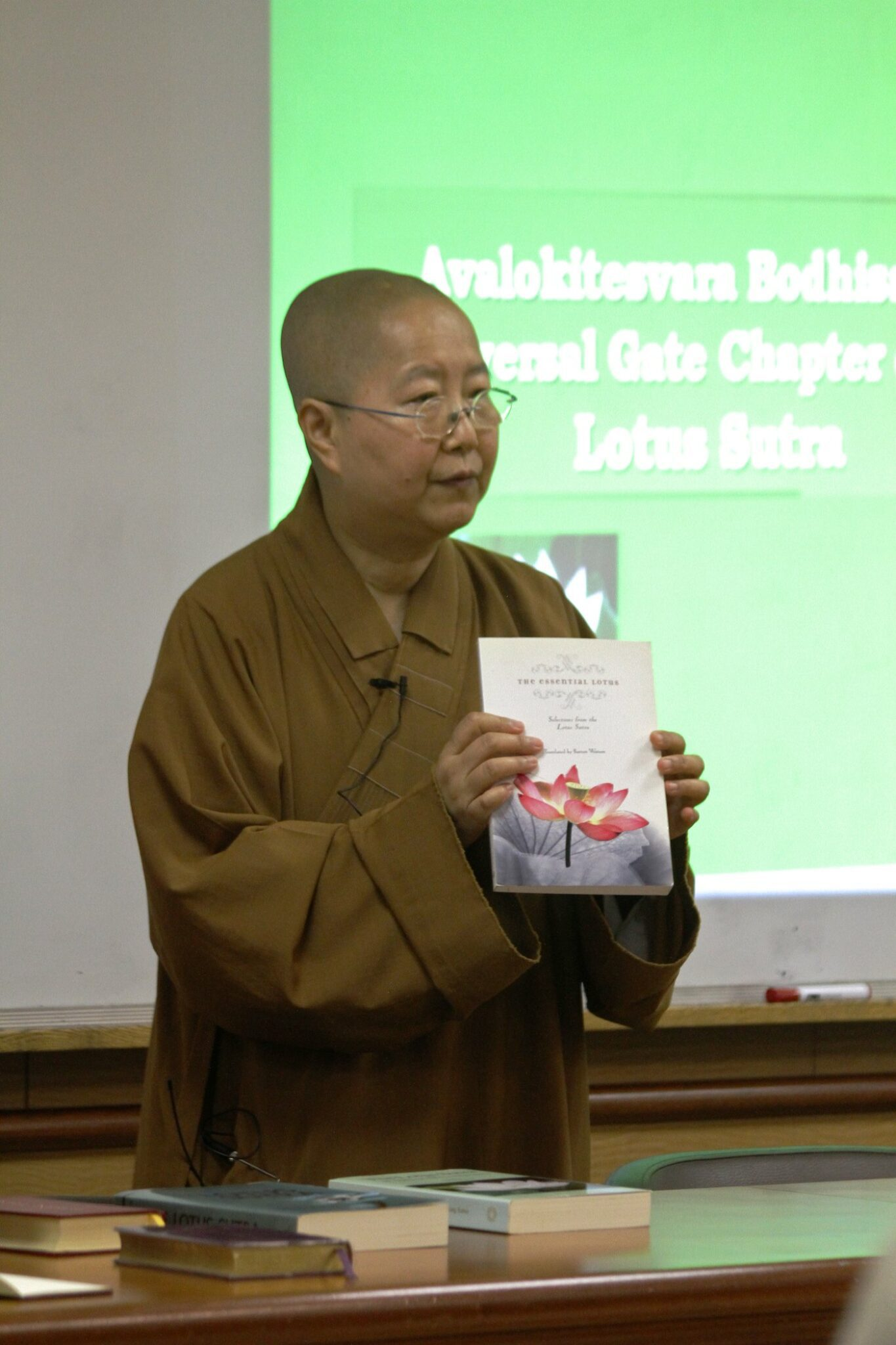 Venerable Miaoshi displays a Lotus Sutra Translation