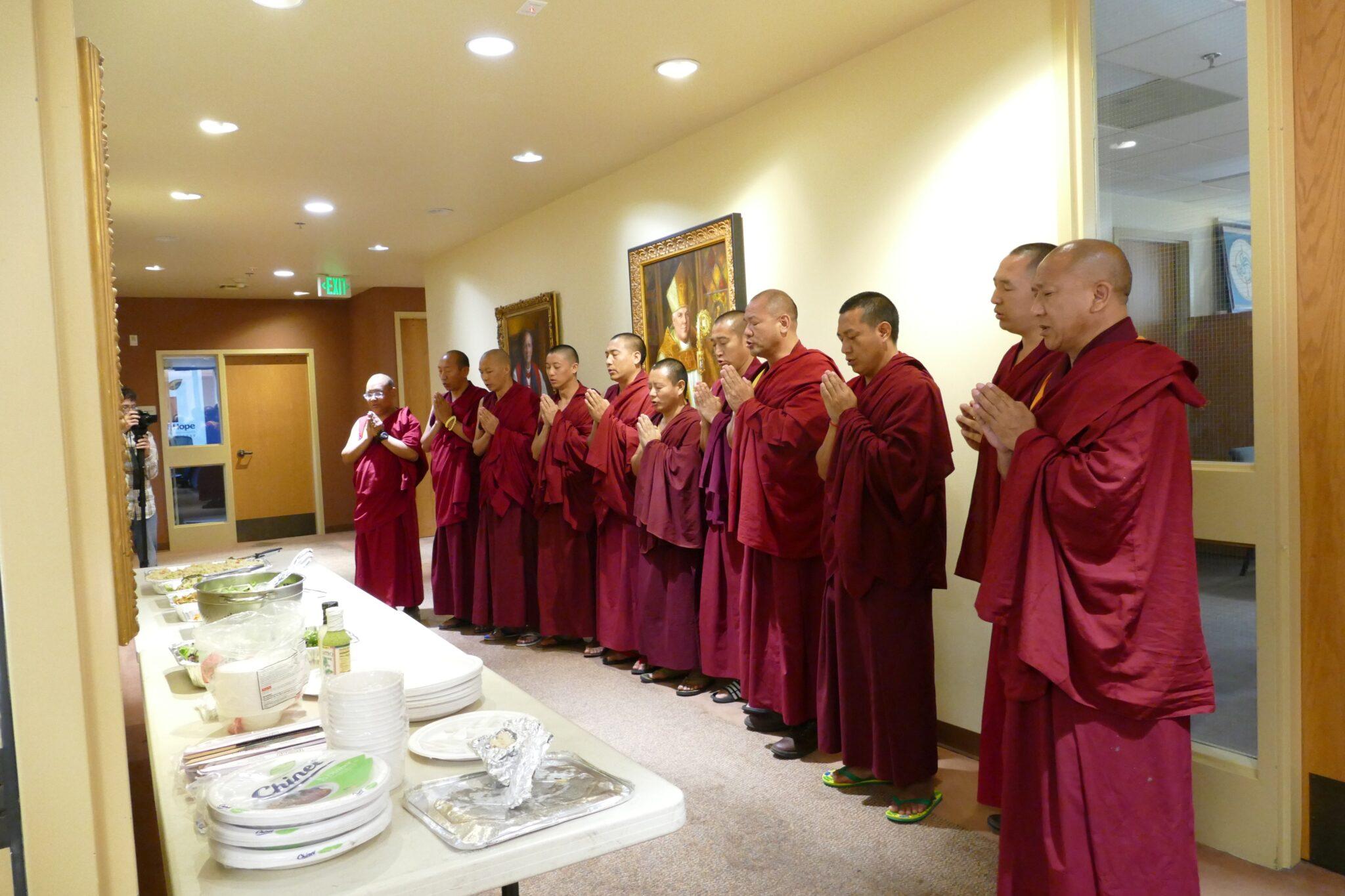 Monks Pray before eating