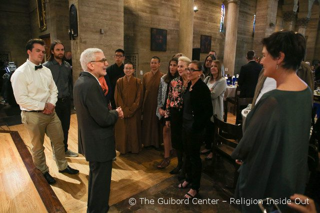 Walter Kilmer leads a tour of St. John's Cathedral before the Dinner